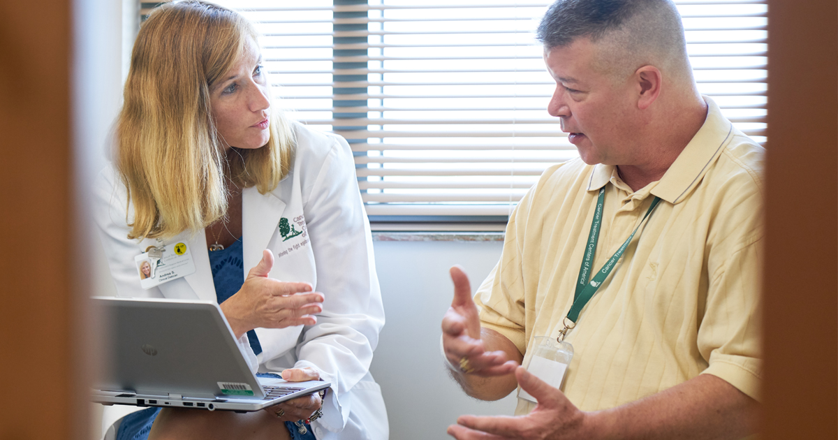 A female physician reviewing next steps with a colon cancer patient