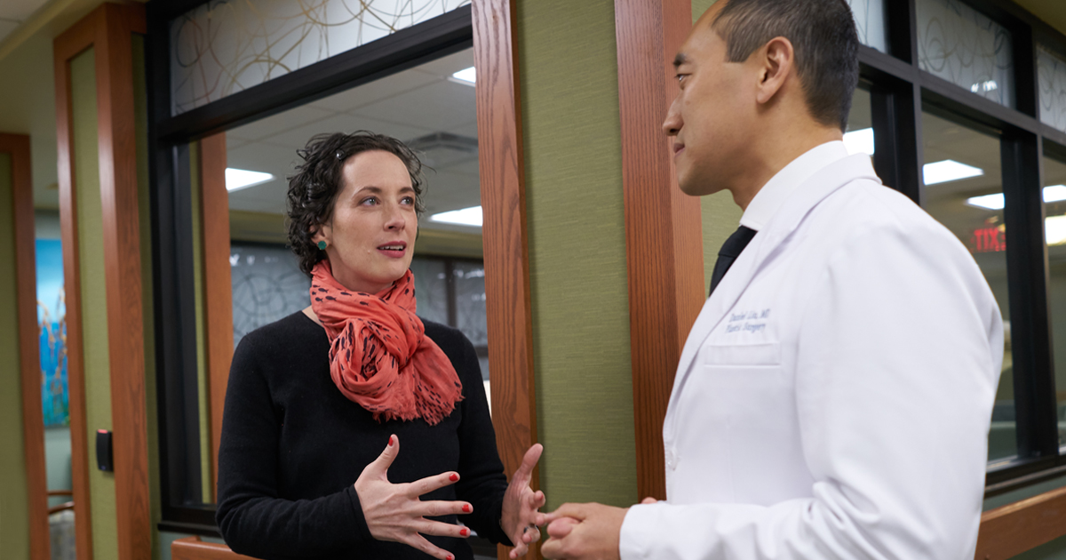 A female patient discussing reconstructive surgery options with a male physician