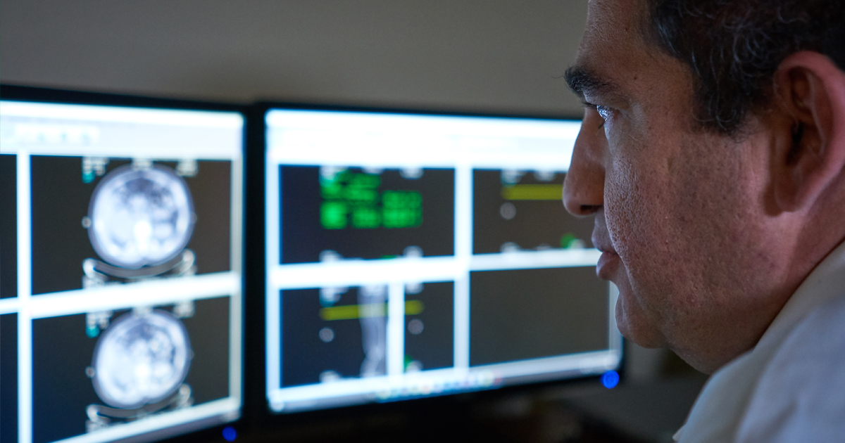 A physician reviewing results on a computer screen for testicular cancer