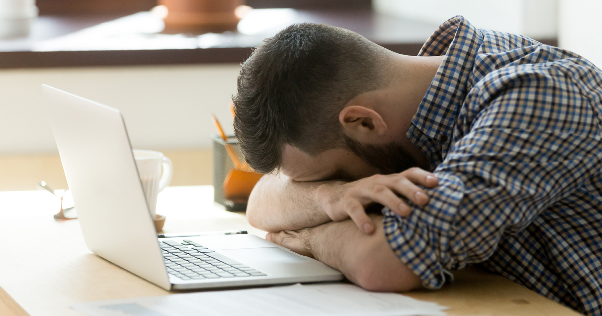 A male cancer patient experiencing fatigue while working
