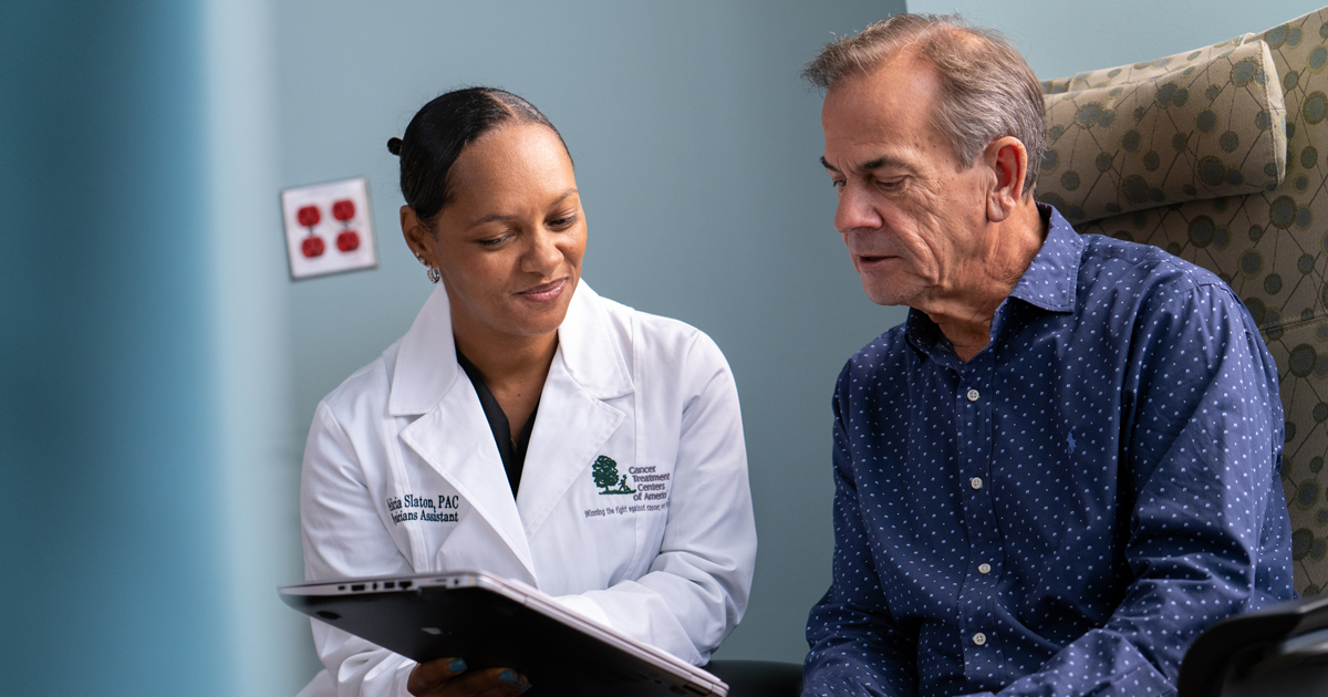A female cancer treatment centers of america physician discussing cancer treatment with a male patient