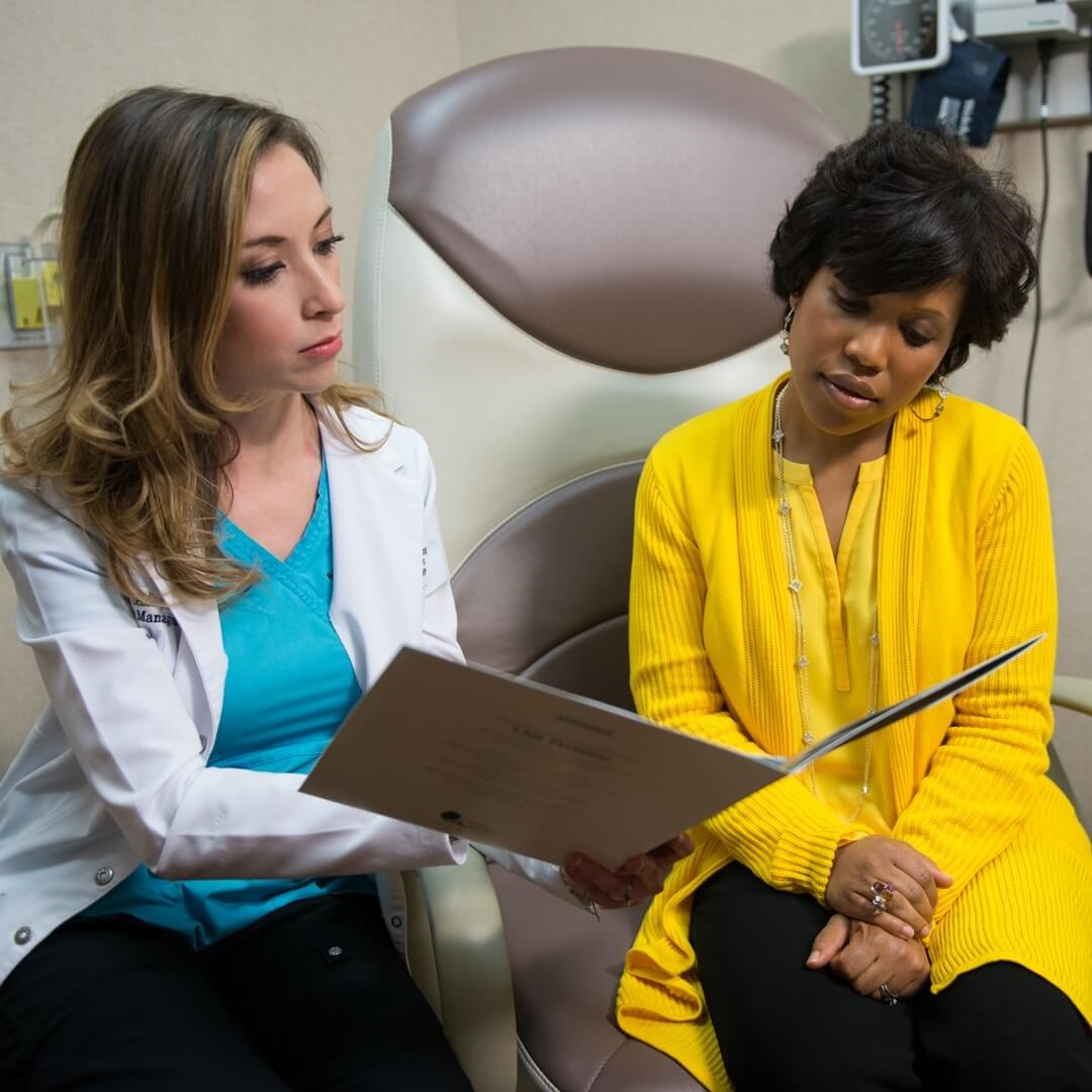 nurse discussing treatment options with multiple myeloma cancer patient