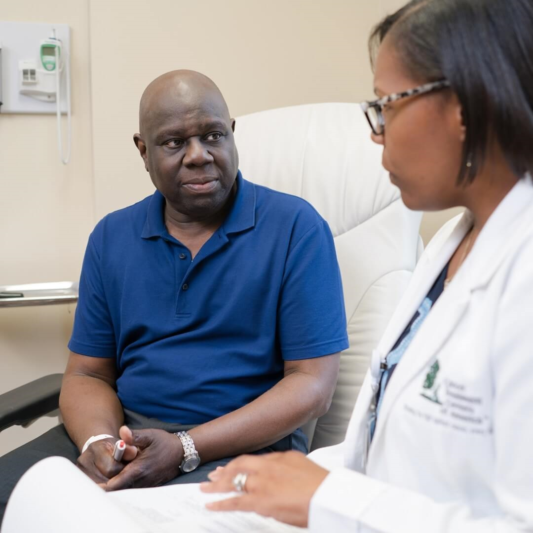 doctor reviewing stomach cancer treatment options with male cancer patient