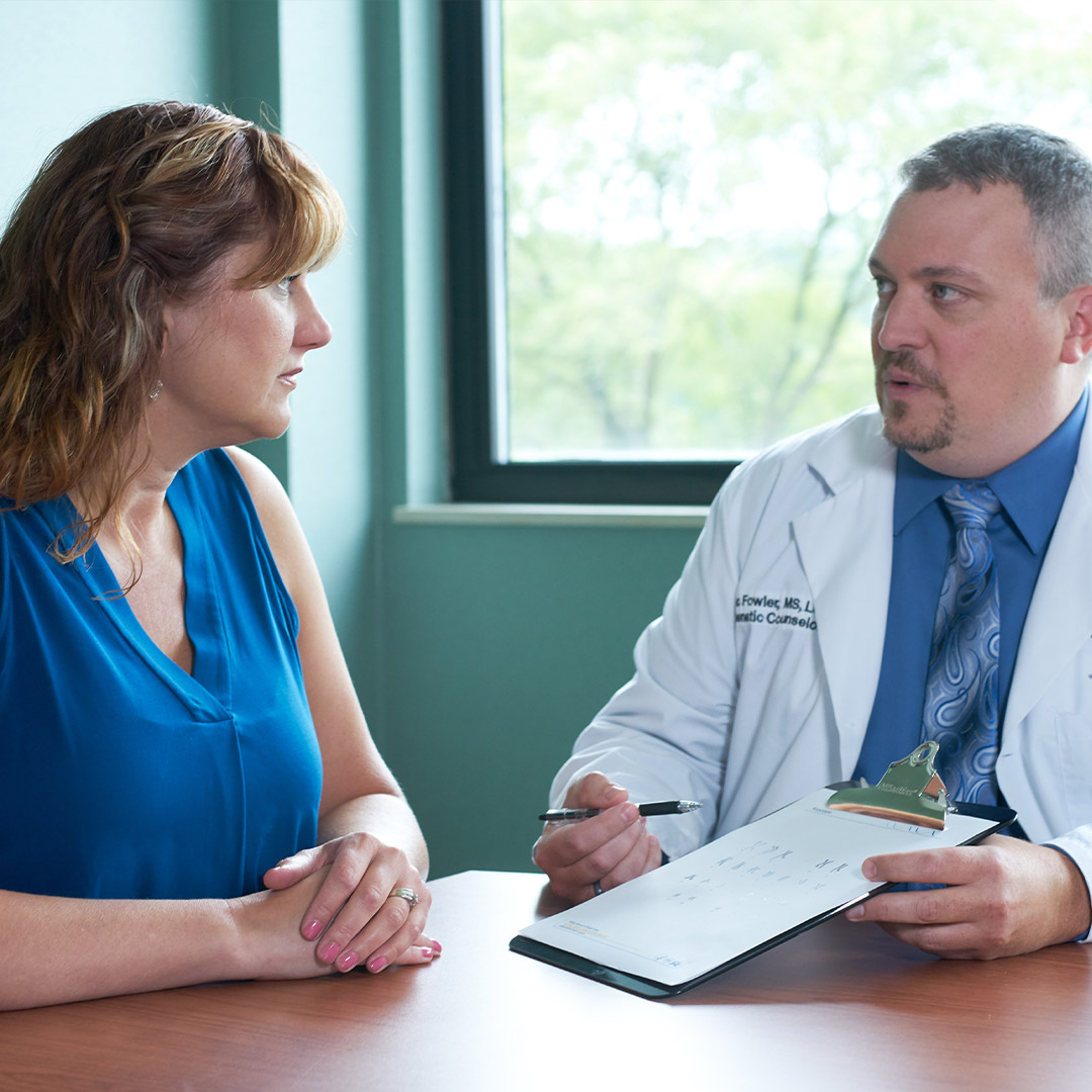 doctor discussion treatment options to patient diagnosed with cancer on the pancreas