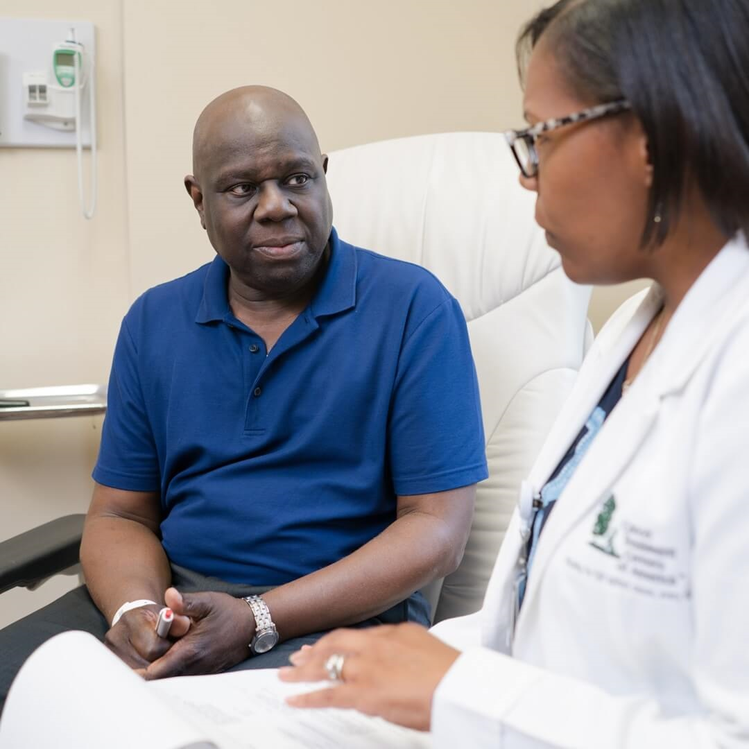 female oncologist discussing treatment options with testicular cancer patient