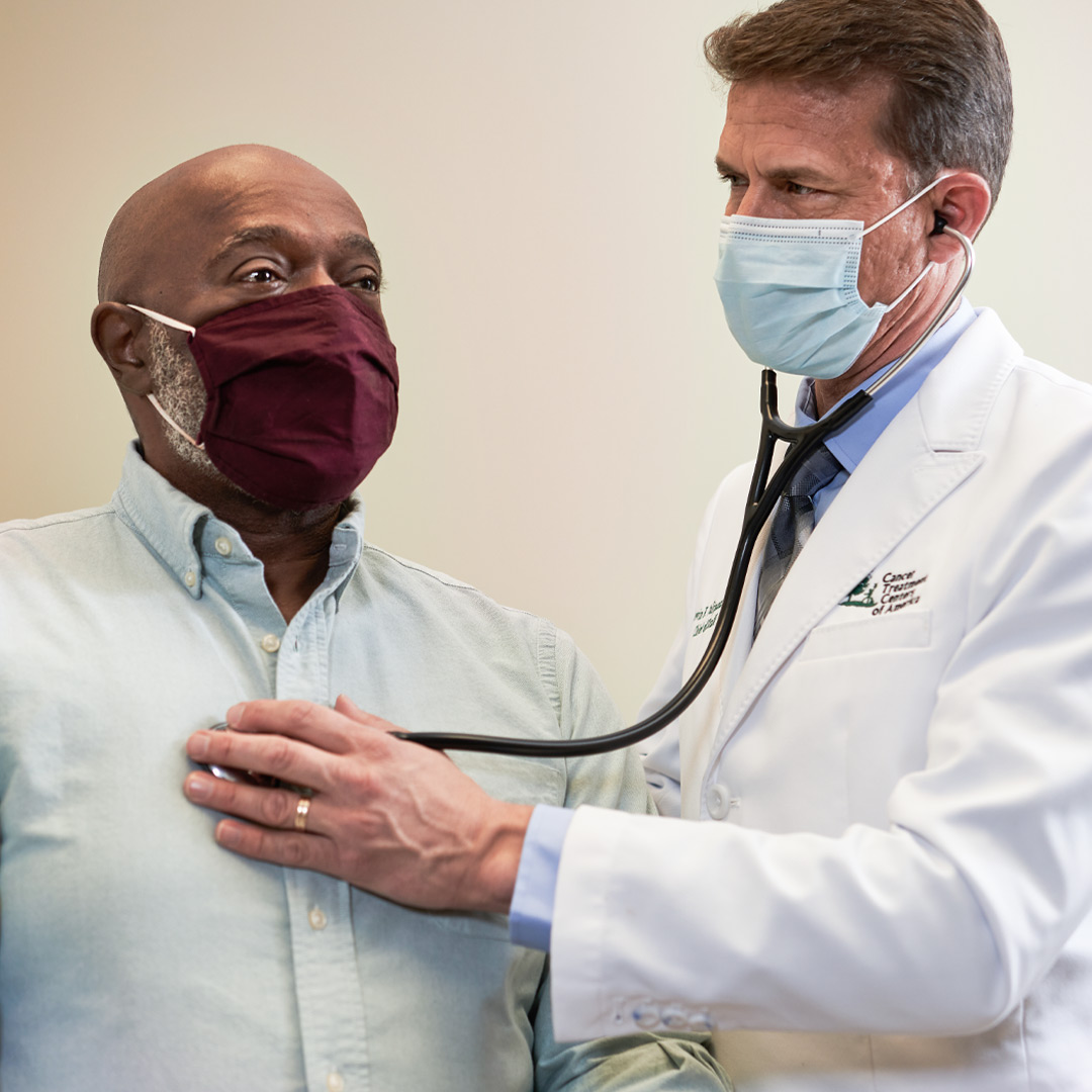 doctor examining lung cancer patient